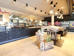 EBG Referenz Bild: Hubers Landhendl - Neubau Shop